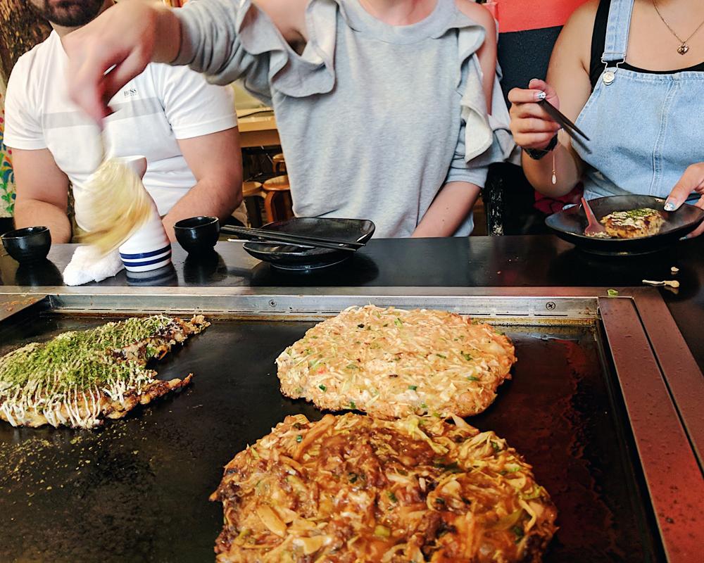 Making our own okonomiyaki at Sakura Tei