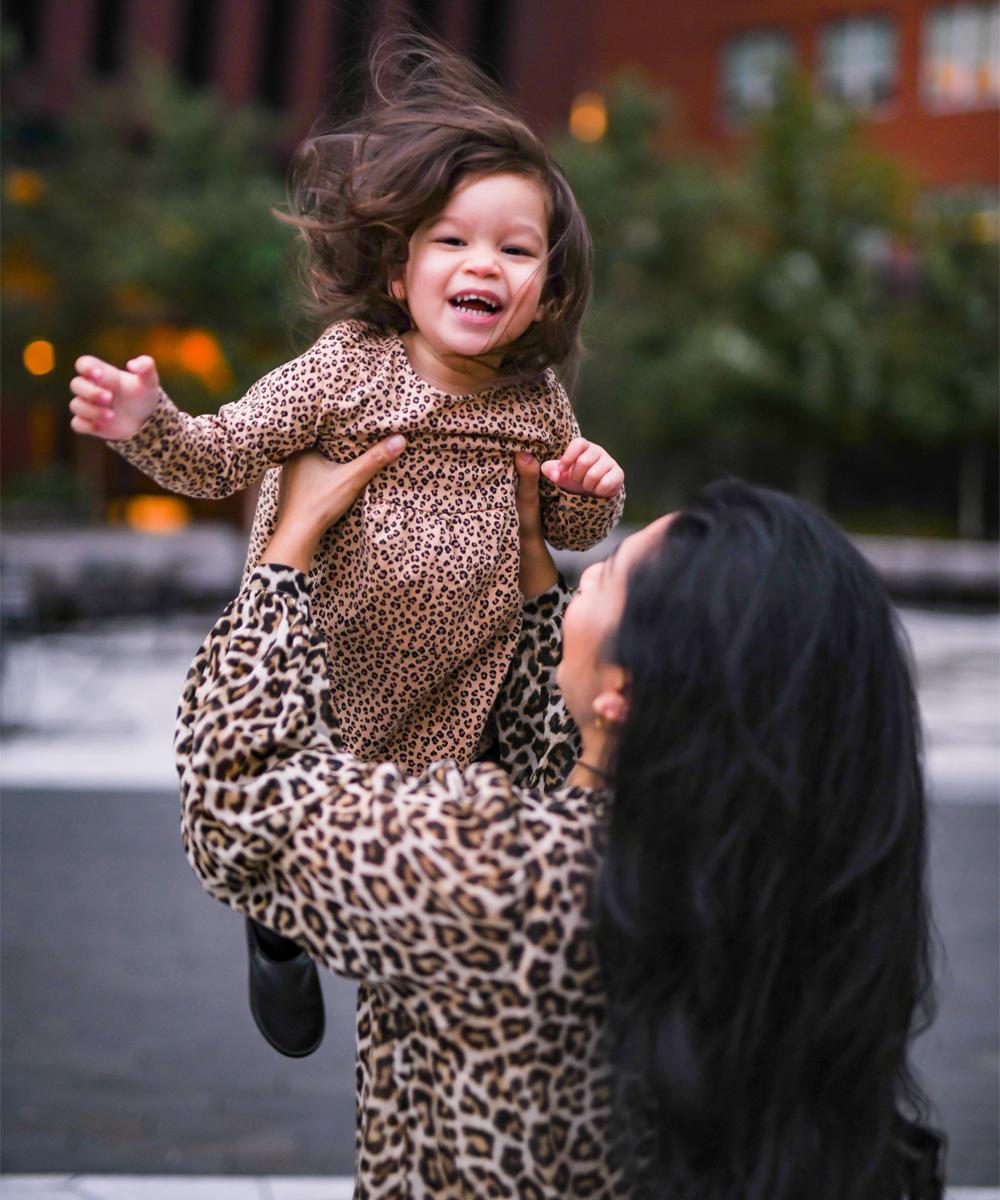 Maxine is servin LEWKS in her H&M leopard print dress